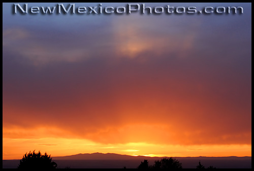 sunset looking west from albuquerque with mt taylor in the distance