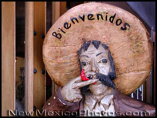 wooden statue of a man with a sombrero that says bienvenidos