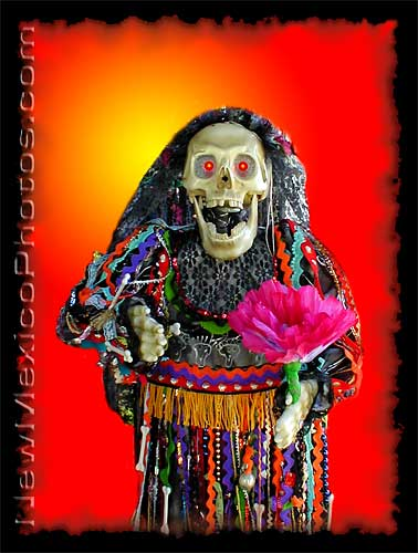 lady skeleton with flowers wishes you a happy halloween and feliz dia de los muertos