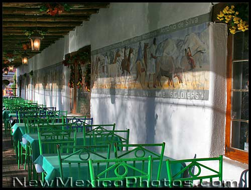 green chairs on a restaurant patio in Old Town Albuquerque