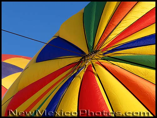 the top of a colorful hot air balloon as it inflates