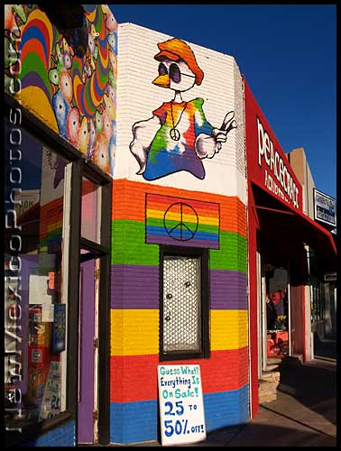 storefronts in Albuquerque's Nob Hill, featuring peace