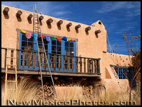 adobe house with prayer flags