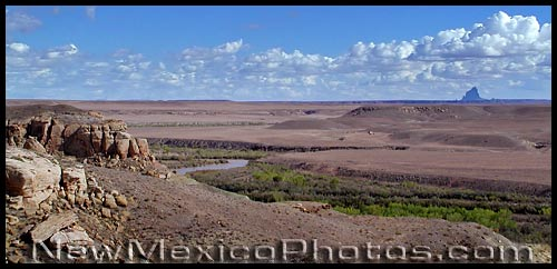 the san juan river with shiprock in the background