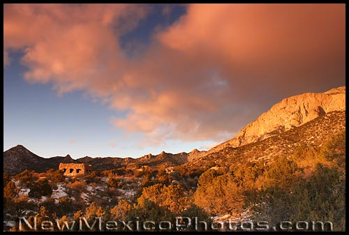 late afternoon sunlight on a stone cabin in the Sandia Mountains