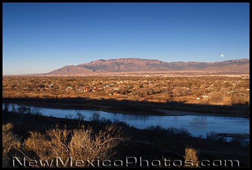 late afternoon moonrise over the Sandia Mountains and Albuquerque