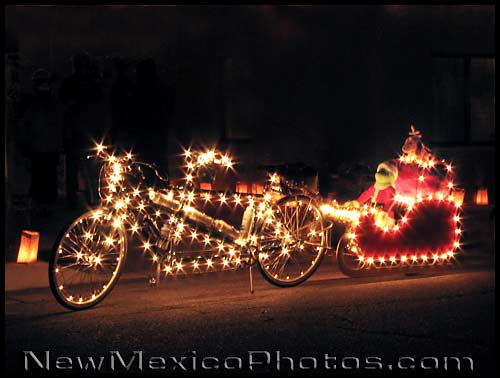 photo of a sleigh pulled by a tandem bicycle covered with christmas lights