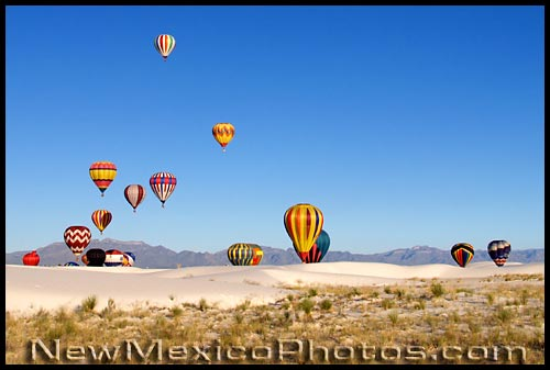 hot air balloons rise over White Sands