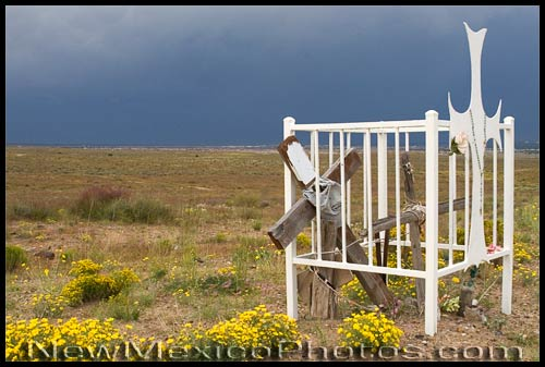 a descanso with a fence, on Albuquerque's southwest mesa