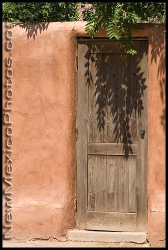 wooden door in an adobe wall
