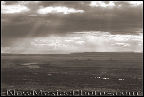 sun breaks through the clouds over Albuquerque's west mesa