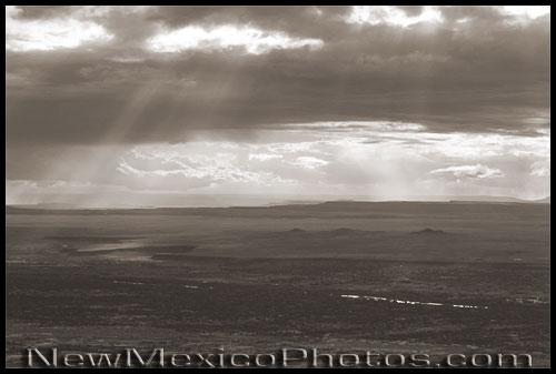 sun breaks through the clouds over Albuquerque's west mesa