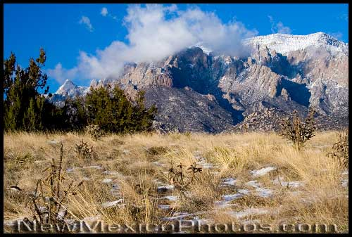 The Sandias are ringed with clouds the day after a storm, during the very snowy winter of 2006-2007