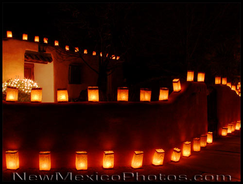 A house lit up with rows of luminarias