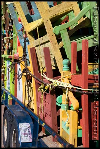 Brightly-colored furniture piled high on a trailer from Chihuahua