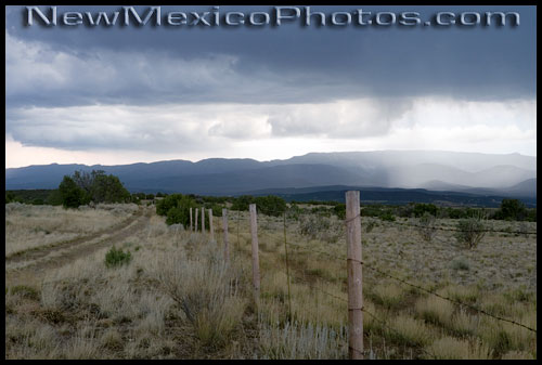 a summer storm east of the sandia mountains