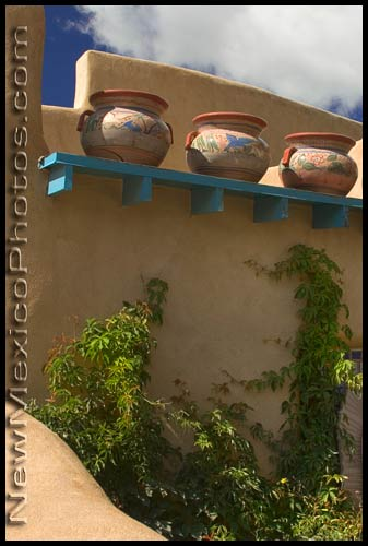 Three large pots overlook a Taos courtyard