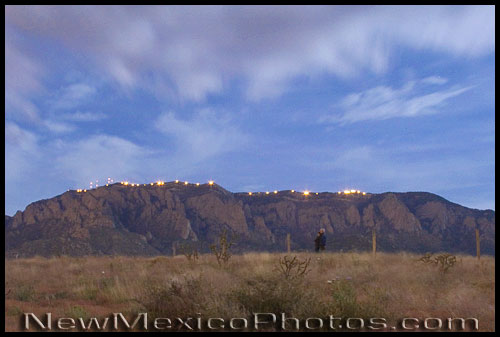 Lights lined up along the crest of the Sandias to commemorate the tricentennial