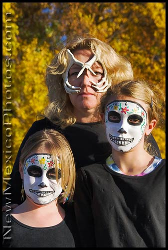 A trio of calaveras prepares to join the annual Marigold Parade and Dia de los Muertos celebration in the South Valley of Albuquerque