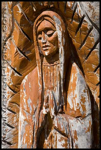 The virgin of Guadalupe, carved into a tree trunk, near Old Town Albuquerque