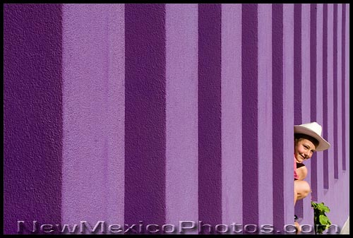 A young cowboy peeks through a wall at the Hispanic Cultural Center in Albuquerque
