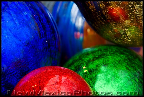 Large blown glass Christmas ornaments in front of a shop in Old Town Albuquerque