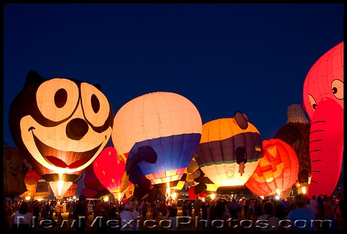 A constellation of familiar characters visits a special shapes balloon glow at the Albuquerque Balloon Fiesta