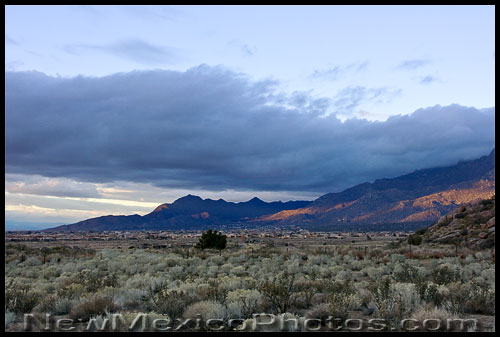 looking north along the west side of the Sandia foothills at dusk