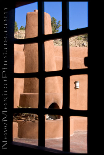 One of several very scenic courtyards at Ghost Ranch, as seen through a small window in the door of the Worship Center