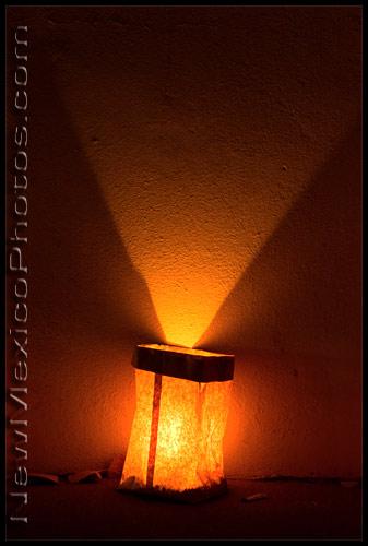 a lone luminaria -- aka farolito