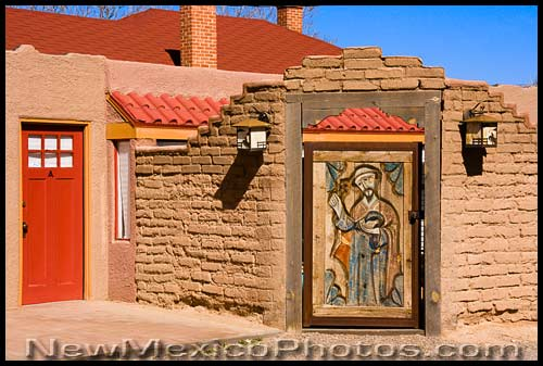 A gate with a carved wood image of St. Francis in the north valley of Albuquerque