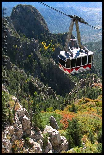 sandia peak tramway passes over vibrant fall colors in the Sandias