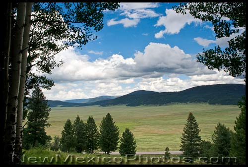 looking out over part of Valles Caldera, with State Highway 4 in the foreground