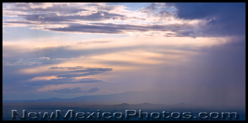 a thunderstorm moves north across Albuquerque