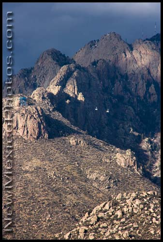 the two sandia peak tramway cars pass each other high above the sandia mountains