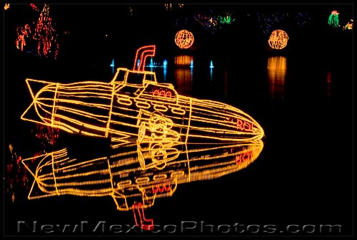 a yellow submarine reflects in the pond at the Rio Grande Botanic Garden